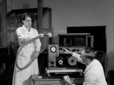 Two scientists use a machine to test smoke pollution 1953