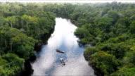 two small river skiffs, black water tributary of the amazon river, peruvian amazon, peru