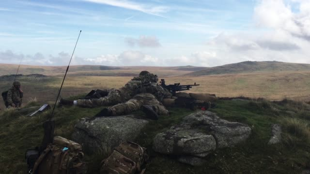 Two soldier's from 6 RIFLES fire live ammunition from a General Purpose Machine Gun on the range at Okehampton Camp Dartmoor during the 6th Battalion...