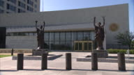MS Two statues in front of Federal Reserve building entrance / Kansas City, Kansas, United States