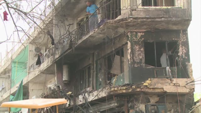 Two suicide car bombs exploded seconds and a few hundred metres apart in a busy area of central Baghdad Thursday killing at least 13 people police...