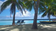 MS, Two sun lounger between palm trees facing ocean, Aitutaki Lagoon, Aitutaki, Cook Islands