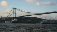 Two Tankers Passing Under The Bosphorus Bridge