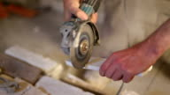 two video clips of construction worker cutting brick tile with grinder