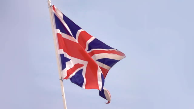 Two videos of British flag in real slow motion