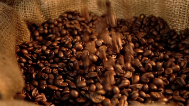 Two videos of falling coffee beans in real slow motion