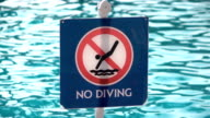 Two videos of no diving sign in real slow motion