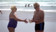 Two videos of senior couple on the beach-real slow motion