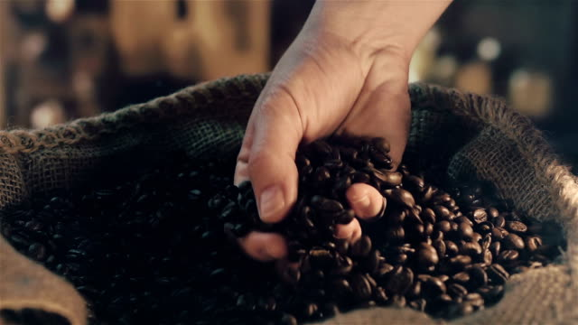 Two videos of taking coffee beans in real slow motion
