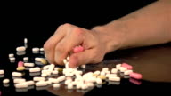 Two videos of taking pills in real slow motion