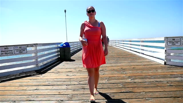 Two videos of woman in California in slow motion