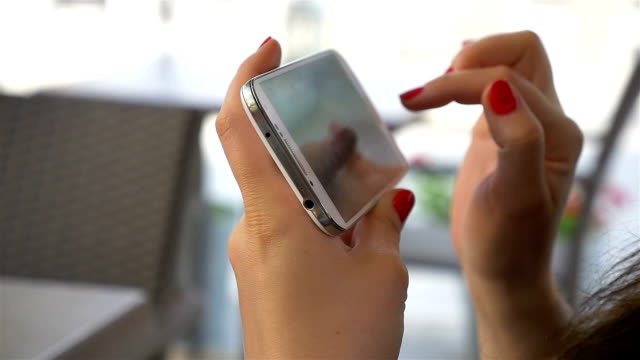 Two videos of woman using phone