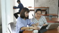 two woman working at cafe