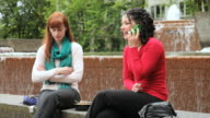 MS Two women at lunch break while phone call disrupts conversation / Portland, Oregon, USA