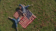 two women dancing with American flags