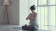 Two women doing yoga meditation and stretching exercises