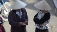 MS Two women exchanging money / Hoi An, Quang Nam, Viet Nam