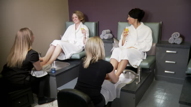 Two women get foot treatments