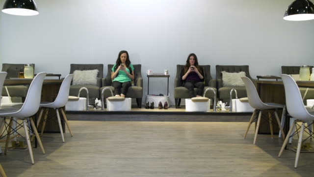 Two women getting a pedicure in a spa