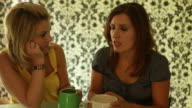 Two women having serious conversion over cup of coffee
