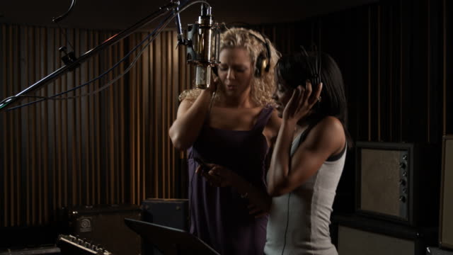 two women in a recording studio