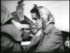 PROFILE two women in babushkas outdoors / refugees after Hungarian revolution / news