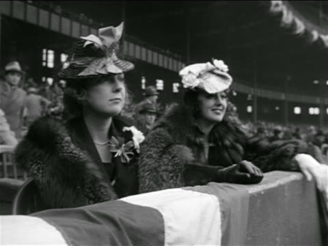 B/W 1939 two women in furs hats sitting in stadium / Lou Gehrig's farewell