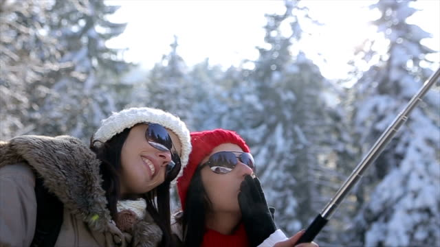 Two women makes a selfie on winter vacation