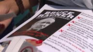 Two women passed out leaflets and information to dissuade people from voting for Bruce Rauner for Illinois governor in the 2014 gubernatorial race in...