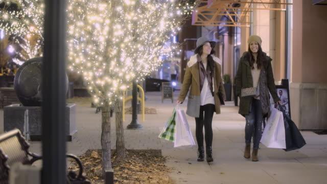 two women shopping at night