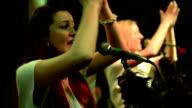 Two women singing.