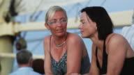 two women talking on a boat