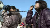 MS Two women with loudspeaker at political demonstration and protest outside White House / Washington DC United States AUDIO