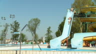 HD SLOW MOTION: Two Young Men On A Waterslide