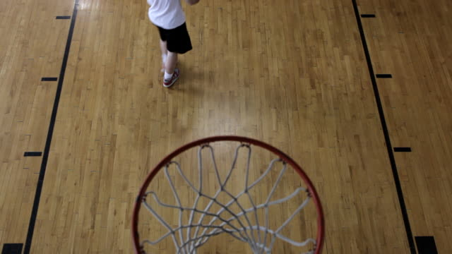 MS Two young men playing basketball against each-other inside  gymnasium / Minneapolis, Minnesota, United States