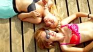 Two young woman sunbathing