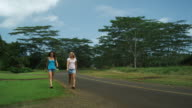 two young women checking out a runner