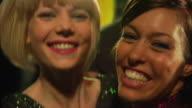 CU SLO MO Two young women dancing at rock concert / London, UK