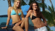 two young women in bikinis