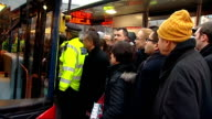 Twoday tube strike begins in London ENGLAND London King's Cross EXT Long queue of Commuters waiting at bus stop / Commuters crowded together at bus...