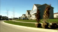 Two-story homes line a Chicago suburb street. Available in HD.
