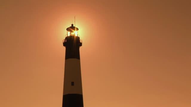 T/L, MS, LA, Tybee Lighthouse against orange sky at sunset, Tybee Island, Georgia, USA