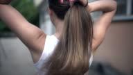 Tying my hair back