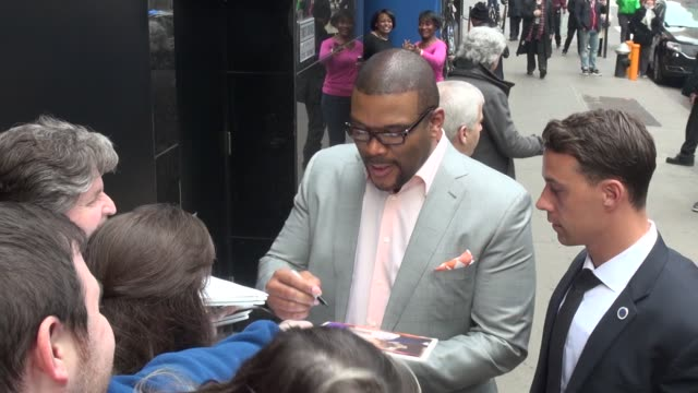 Tyler Perry exits the Good Morning America show signs for fans before leaving in Celebrity Sightings in New York