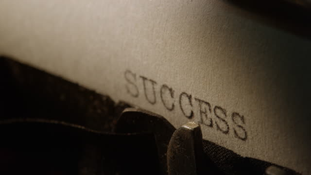 LD Type bars of old typewriter printing the word SUCCESS