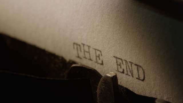 LD Type bars of old typewriter printing words THE END