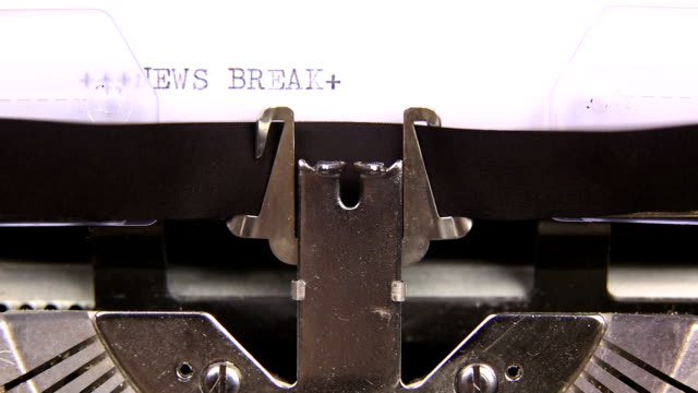 HD NEWS BREAK WEATHER HEADLINES typed  on an old typewriter