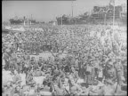 Typewriter message / docks at Alexandria Egypt jammed with soldiers in uniform ships / soldiers walk down stairs to dock / soldiers on pier with...