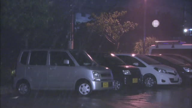 Typhoon generated rainstorm whips the parked vehicles / Typhoon No19 Vongfong hit Kagoshima on October 13 2014 and swept through the Japanese...