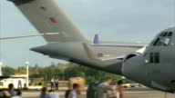 American aid begins to reach Tacloban PHILIPPINES Cebu EXT RAF military aircraft taxiing on runway
